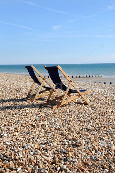 Dois recorrer praia cadeira Foto stock © russwitherington