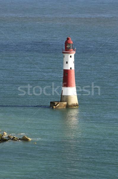 Phare rouge blanche calme eau mer Photo stock © russwitherington