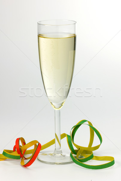 Champagne Glass and streamer Stock photo © russwitherington