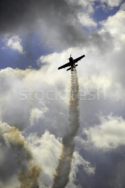 Avion fumée sentier nuages ciel Photo stock © russwitherington