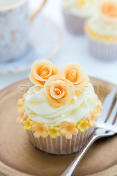Stock photo: Golden cupcake