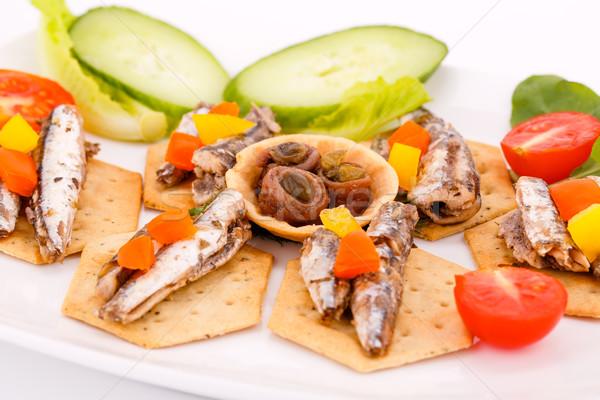 Fish on crackers Stock photo © ruzanna