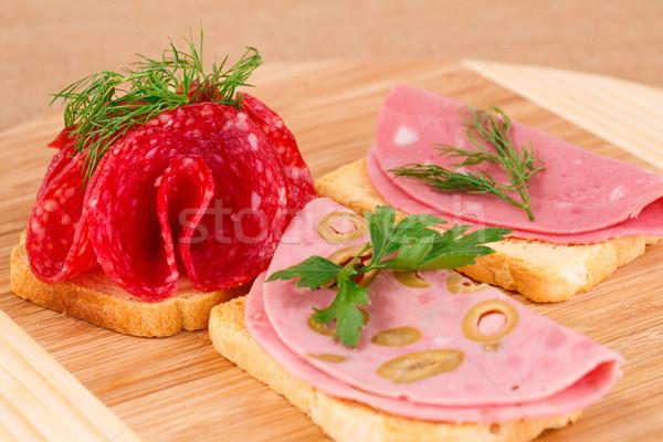 Sanduíches salame comida fundo verde Foto stock © ruzanna