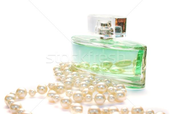 Perfume and necklace Stock photo © ruzanna