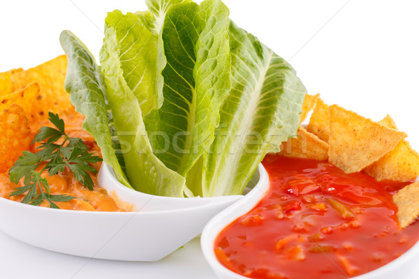 Nachos, cheese and red sauce,  vegetables Stock photo © ruzanna