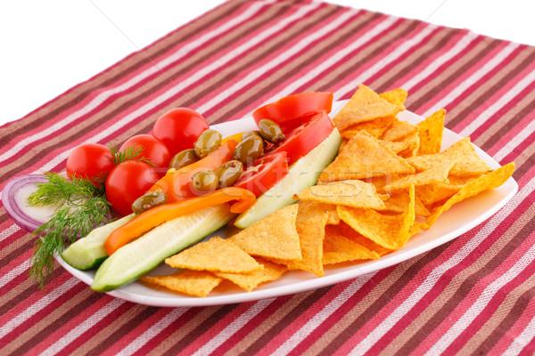 Legumes azeitonas nachos prato colorido toalha de mesa Foto stock © ruzanna