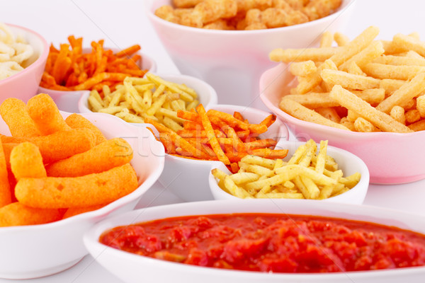 Potato, corn and wheat chips in bowls Stock photo © ruzanna