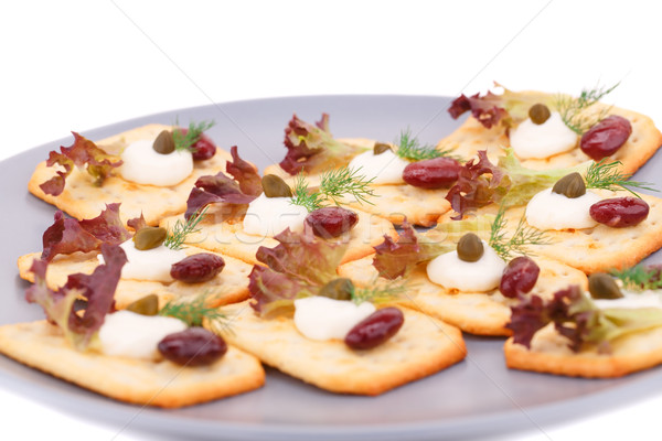 Crackers with red kidney beans and cream Stock photo © ruzanna