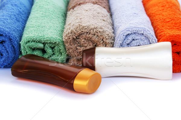 Foto stock: Toalhas · xampu · garrafas · colorido · branco · praia