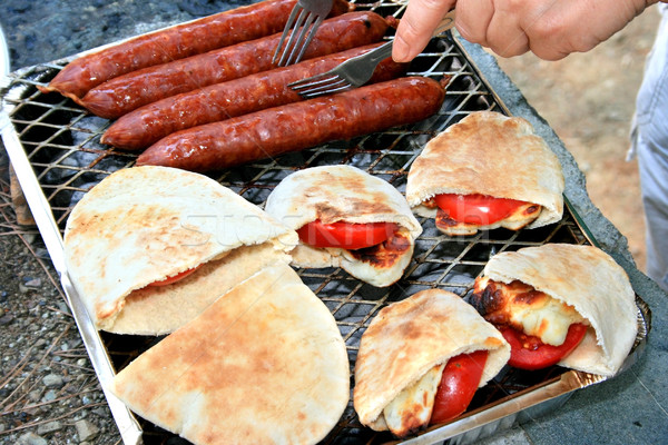Grilled sausages,halloumi cheese with tomatoes in pita bread.  Stock photo © ruzanna