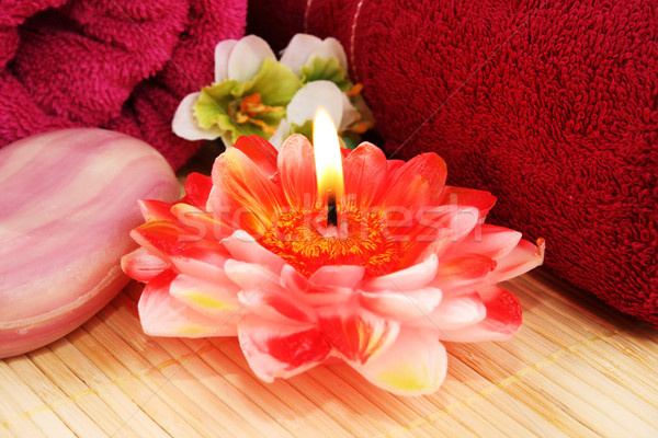 Towels, soap,  candle, flowers Stock photo © ruzanna