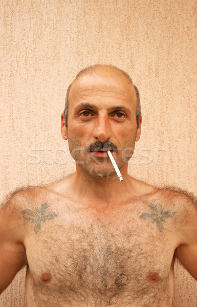 Smoking man Stock photo © ruzanna