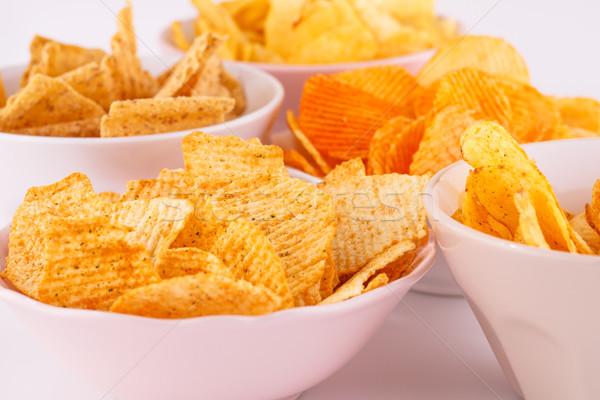 Potato and wheat chips in bowls Stock photo © ruzanna