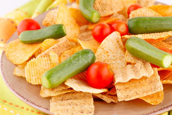 Burgonyaszirom zöldségek tányér konyha törölköző háttér Stock fotó © ruzanna
