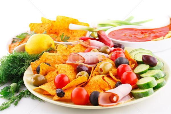 Nachos, olives, pork loin and vegetables Stock photo © ruzanna