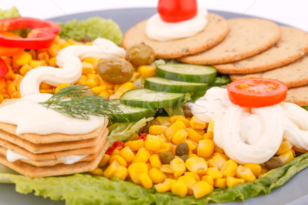 Snack with vegetables and crackers Stock photo © ruzanna
