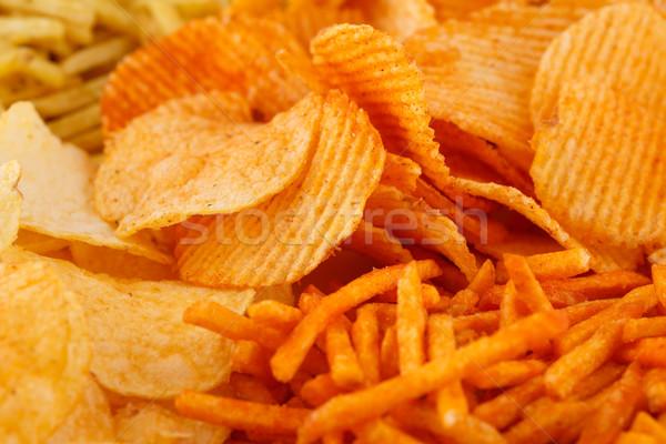 картофельные чипсы изображение оранжевый группа еды Сток-фото © ruzanna