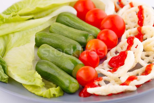 Potato chips and vegetables Stock photo © ruzanna