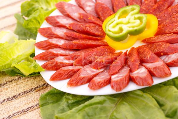 Zöldségek friss kolbászok paprikák tányér zöld Stock fotó © ruzanna