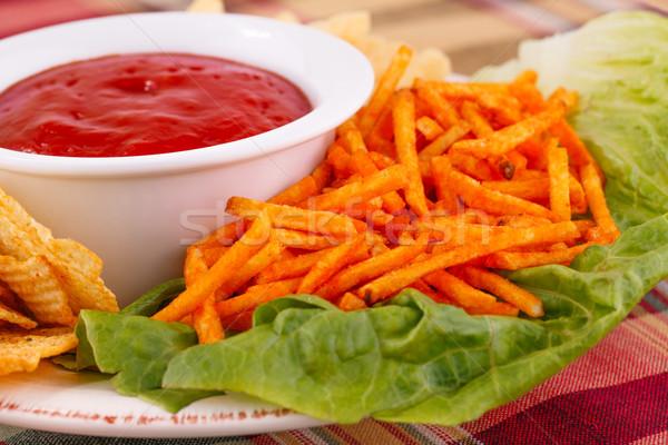 Potato chips and red sauce Stock photo © ruzanna