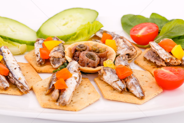 Stock photo: Fish on crackers