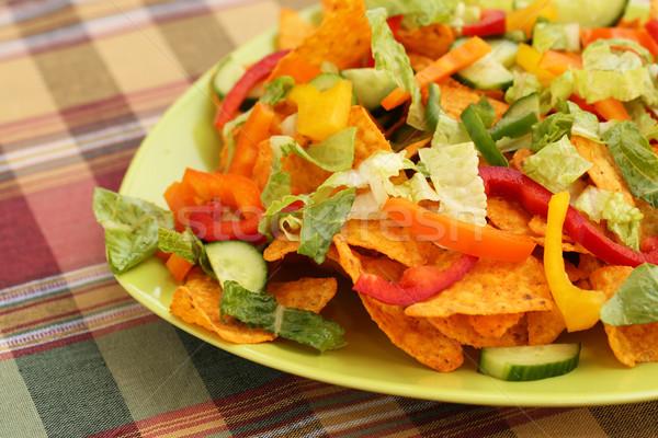 Nachos halom zöldségek zöld tányér kukorica Stock fotó © ruzanna