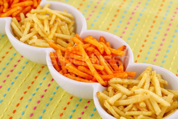 Chips kom kleurrijk tafelkleed achtergrond groep Stockfoto © ruzanna