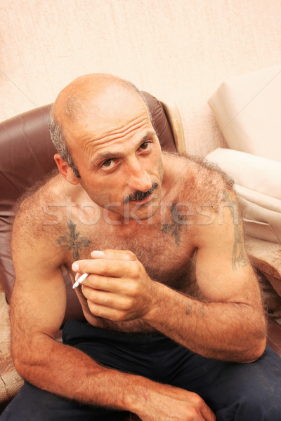Sigara içme adam dikey resim yüz vücut Stok fotoğraf © ruzanna
