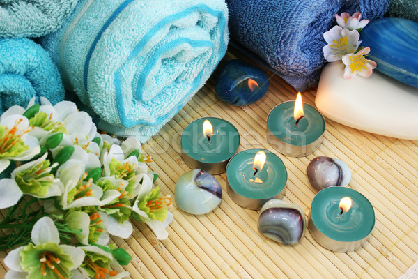 Towels, soaps, flowers, candles Stock photo © ruzanna