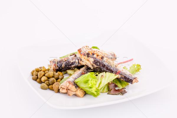 Peces placa pimientos lechuga blanco alimentos Foto stock © ruzanna