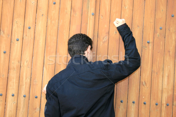 Teen knocking the door Stock photo © ruzanna