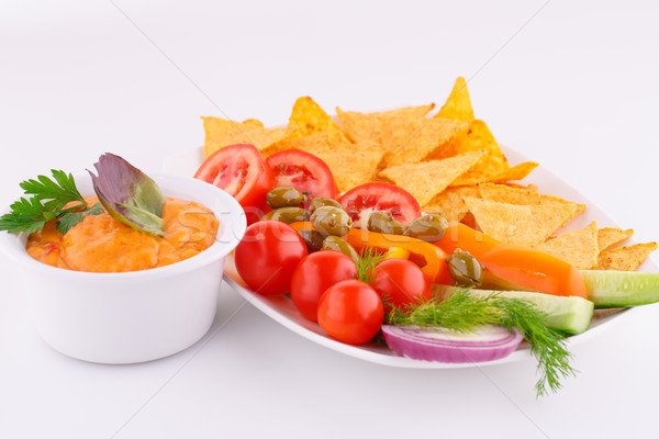 Vegetables, olives, nachos and cheese sause Stock photo © ruzanna