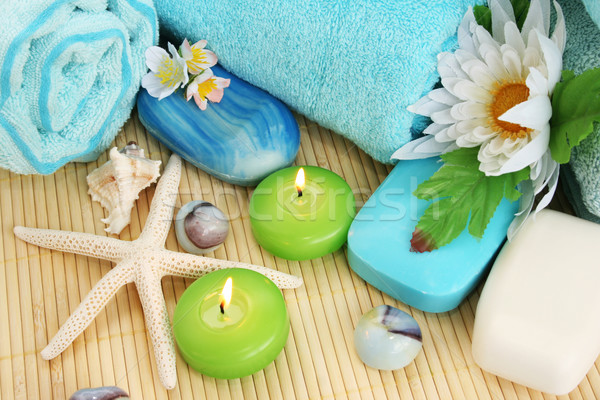 Towels, soap, flower, candles Stock photo © ruzanna