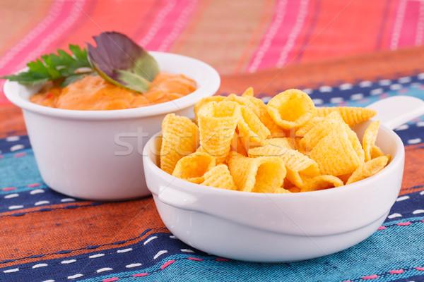 Foto stock: Nachos · queso · salsa · colorido · toallas · fondo