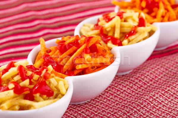 картофельные чипсы кетчуп изолированный красочный скатерть фон Сток-фото © ruzanna