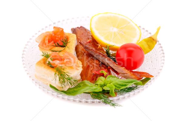 Füstölt hal friss zöldségek citrom tányér izolált Stock fotó © ruzanna