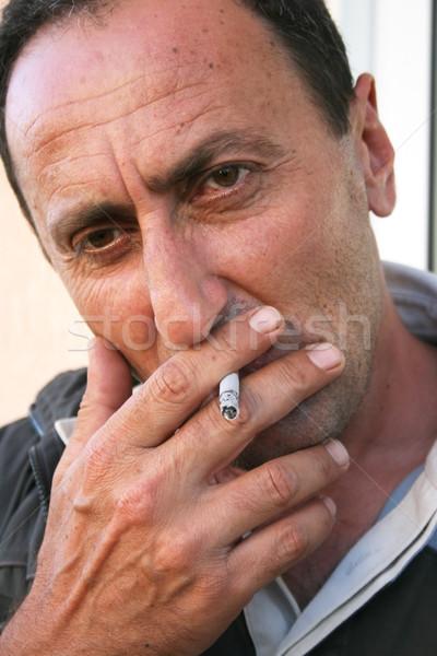Smoking man Stock photo © ruzanna