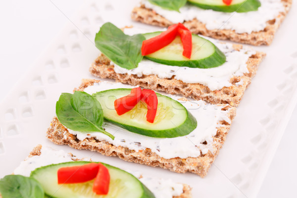 Cracker with fresh vegetables and cream Stock photo © ruzanna