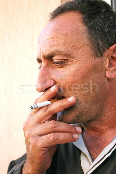 喫煙 男 垂直 肖像 手 顔 ストックフォト © ruzanna