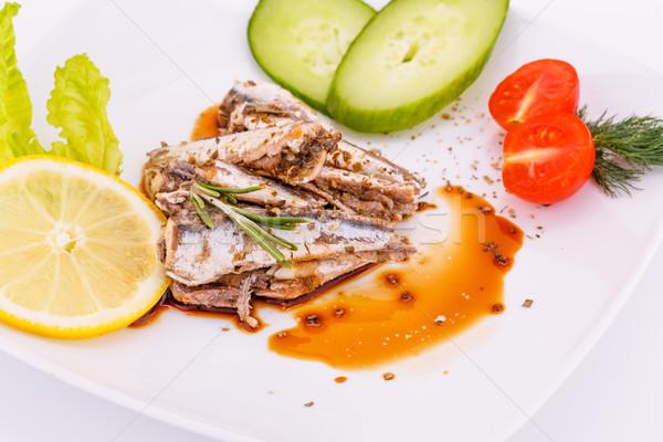 Stock fotó: Hal · zöldségek · citrom · fehér · tányér · bors