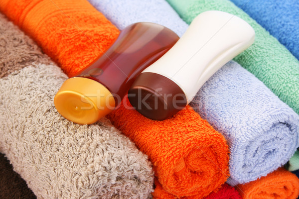 Serviettes shampooing bouteilles coloré plage orange Photo stock © ruzanna