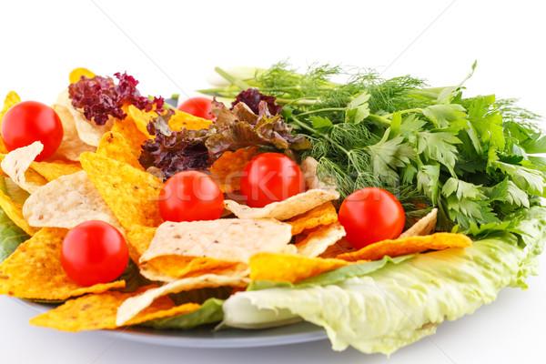 Nachos cseresznye saláta gyógynövények tányér fehér Stock fotó © ruzanna