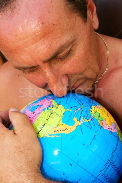 Man hugging the globe Stock photo © ruzanna