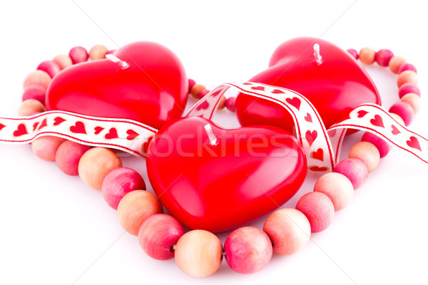 Stock photo: Red heart candles and necklace