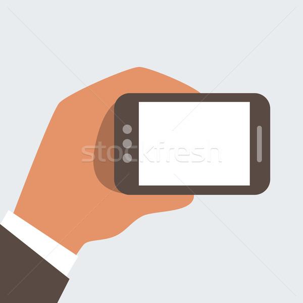 üzletember kezek tart mobiltelefon képernyő szabad Stock fotó © sabelskaya