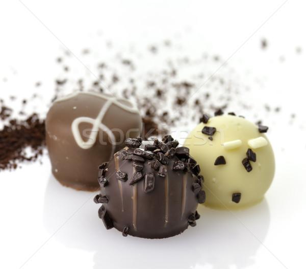 Csokoládé cukorkák finom közelkép fehér textúra Stock fotó © saddako2
