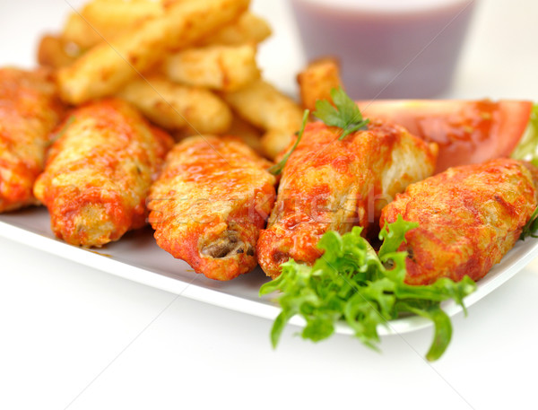 hot chicken wings with fried potatoes and sauce  Stock photo © saddako2