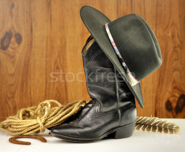 Nero cappello da cowboy stivali sfondo pelle paese Foto d'archivio © saddako2