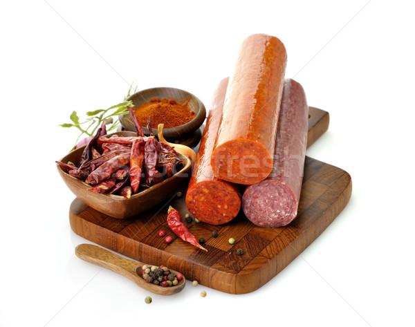 Pepperoni salami épices planche à découper fond orange Photo stock © saddako2