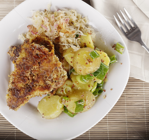 Schnitzel With Potato Salad and Sauerkraut Stock photo © saddako2